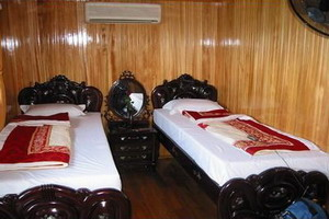 Bed room in 2-cabin Bai Tho Junk Halong Bay